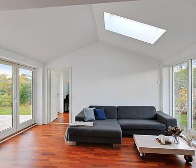 Ny 30 m2 tilbygning med Junckers Merbau gulv og KPK vinduer til hus i Helsingør