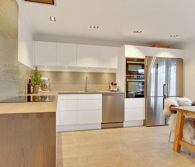 Nyt Svane køkken med egetræsbordplade og Quooker vandhane i Hillerød