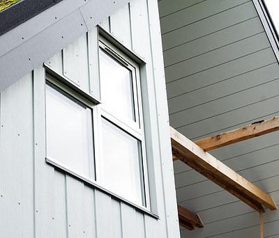 Facadebeklædning og nye Velfac vinduer til hus i Haslev nær Næstved