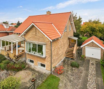 Nyt 170 m2 klassisk rødt tegltag fra Monier til hus i Hellerup